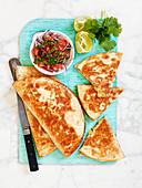 Bean tortilla with mexican tomato salad