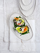 Oysters on salicornia with salmon caviar and vegetables