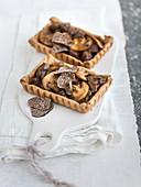 Savory wild mushroom tartlets with sliced truffles