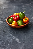 Mini peppers in a wooden bowl