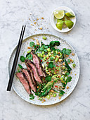 Asian beef salad with glass noodles and green vegetable