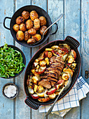 Roasted pork with oven potatoes, parsnips and apples