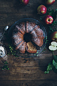Apple wreath cake on a rustic wooden table