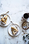 Two pieces of apple cake with almonds