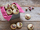 Spiced vegan sesame seed biscuits with white chocolate, pistachio nuts and rose petals
