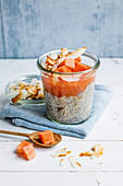 Chia coconut pudding with papaya and coconut chips