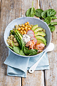 Quinoa bowl with salmon and vegetables