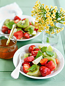 Fruit salad with kiwi, strawberries and mint