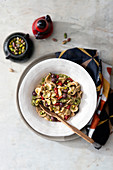 Whole grain orecchiette with endive cream, olives and pistachios