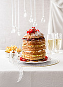 Panettone cake with vanilla cream, chocolate, raspberries and pears