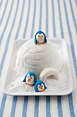 Igloo cake decorated with penguins
