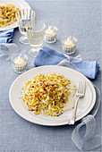 Tagliatelle with taleggio cream, hazelnuts and crispy crumbs