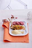 Cotechino with mashed potatoes and savoy cabbage