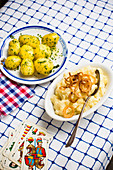 Parsley potatoes, and mashed potatoes with roasted onions