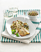 Oven-roasted mackerel fillets with salsa verde and almonds