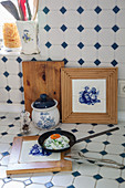 Delft tiles in wooden frames used as trivets