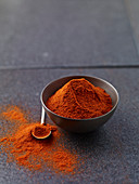Paprika powder in a grey bowl