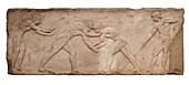 Wrestlers funerary bas relief.