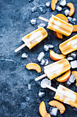 Popsicles made from peaches, orange juice and greek yogurt