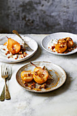 Pears poached in perry with chantilly cream and candied walnuts