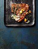 Herby t-bone steak with garlic confit