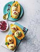 Mango and ice cream with pomegranate rubies
