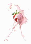A strawberry with a strawberry milk splash
