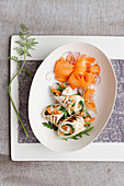 Chicken breast rolls with carrot and rocket stuffing and carrot salad