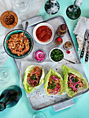Vegeterian tacos with nuts, pickled red onion, spicy sauces, coriander and chiliflakes