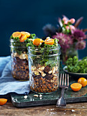 Lentil salad with nuts, kale, dried dates and physalis