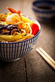 Asian noodles with prawns served in a bowl