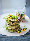 Edamame burger with a spicy mango and orange salsa