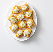 Fried polenta slices with cream cheese and sprouts