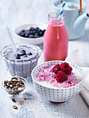 Healthy breakfast with chiapudding with blueberries, smoothie, porridge with raspberries, pumpkinseeds
