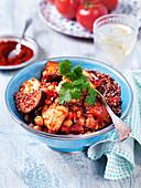 Quinoa salad with chickpeas, tomatoes, smoked paprika, aubergine, cauliflower, coriander