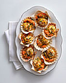 Gratinated scallops with orange butter