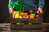 Fresh fruits in a wooden box