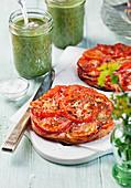 Mini tomato tarts and green soup in jars
