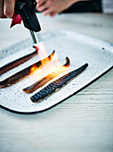 Cooking with a blowtorch gives the mackerel crisp, smoky skin