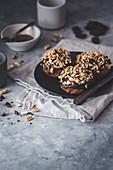 Vegan doughnuts with a caramel filling, chocolate ganache and peanuts