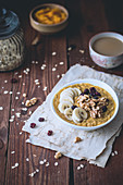 Pumpkin porridge with bananas, dried cranberries and walnuts