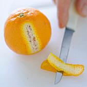 Orange with sliced orange peel
