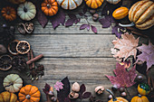 Pumpkins with leaves and autumn spices