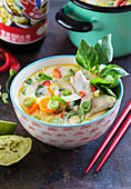 Tom kai fish soup with thaibasil, lime, leek, chili, carrots and coconnut milk