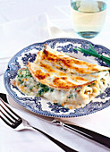 Gratinated pancakes with a spinach and ricotta filling