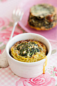 Oven cooked mini spinach frittata with raisins and pine nuts