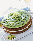 Kiwi cake with orange cream