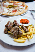 cevapi with fried potatoes