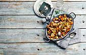 Roasted chicken pieces with root vegetable
