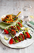 Duck skewers with red pepper and spring onions